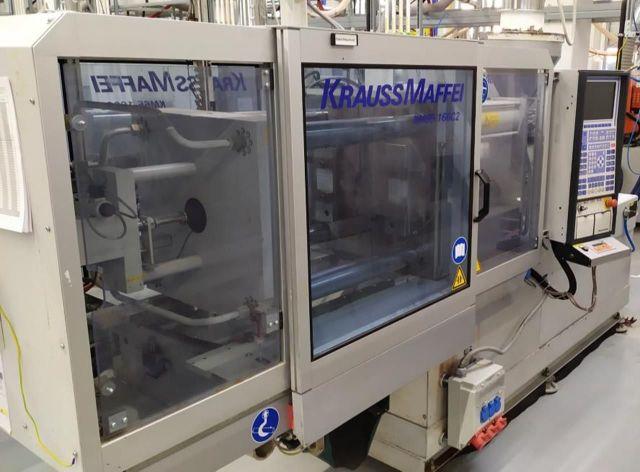 Vstrekovanie plastov lis KRAUSS MAFFEI 65-160 C2 2000